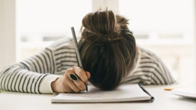 writers-block-woman-with-head-on-pad-714x402