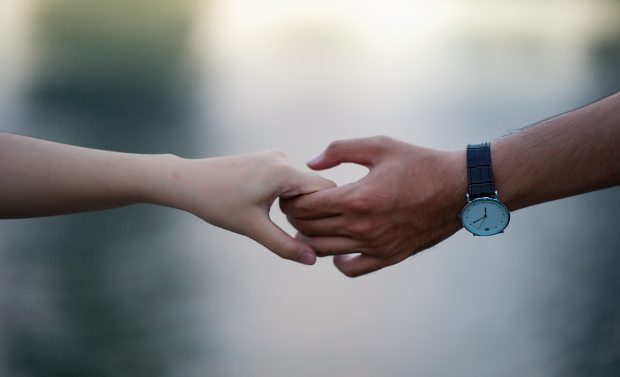 blurred-background-hands-holding-hands-715807.jpg